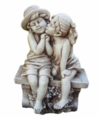 Boy And Girl Kissing On Bench